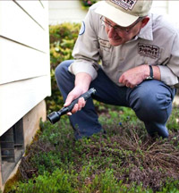 Pest control technician inspecting home. Pioneer Pest Management serving Portland OR and Vancouver WA talks about 10 ways to rodent-proof your home.