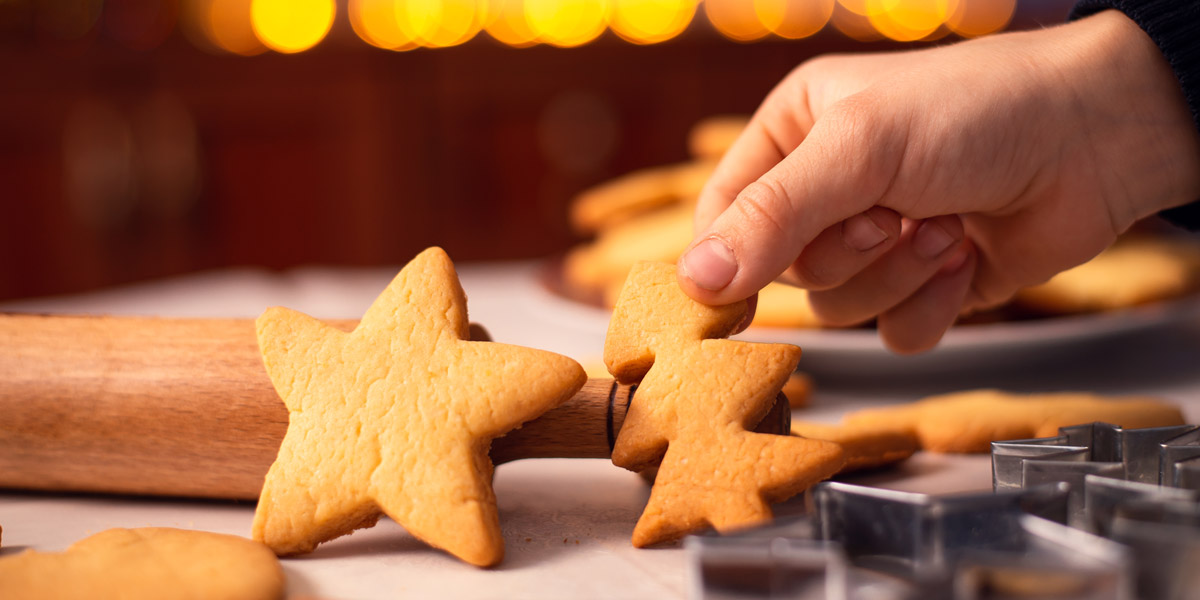 Cookies in star and Christmas tree shapes on the table near rolling pin and baking accessories. Pioneer Pest Management, serving Portland OR & Vancouver WA talks about pantry pests and holiday baking.